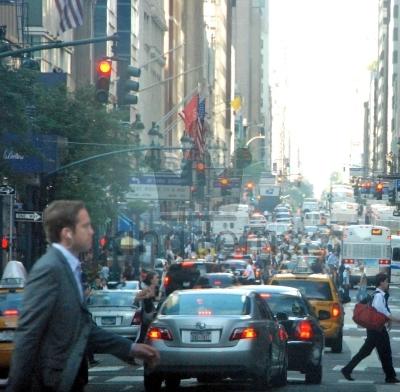 Man Crossing Busy Road