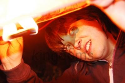 Girl Lighting Lantern
