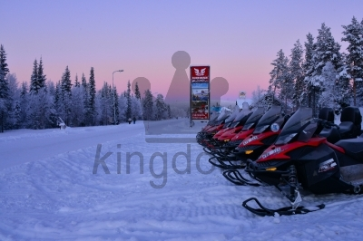 Row Of Snowmobiles